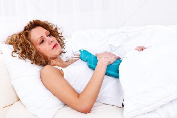 Stock photo: Woman having stomach pain