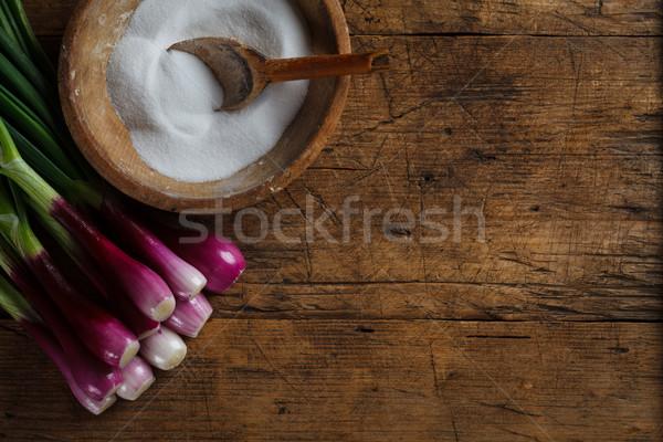Wooden salt storage and onions Stock photo © kalozzolak