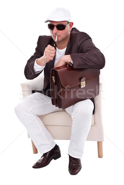 Stok fotoğraf: Yakışıklı · adam · aydınlatma · sigara · adam · oturma · koltuk
