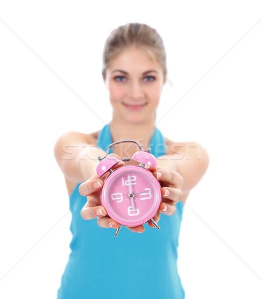 Girl with alarm clock Stock photo © kalozzolak