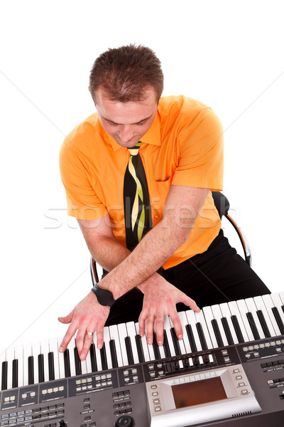 Boy plays on synthesizer Stock photo © kalozzolak