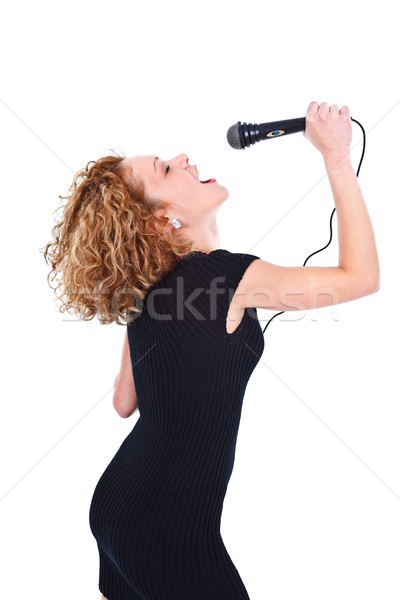 Stock photo: Woman singing in microphone