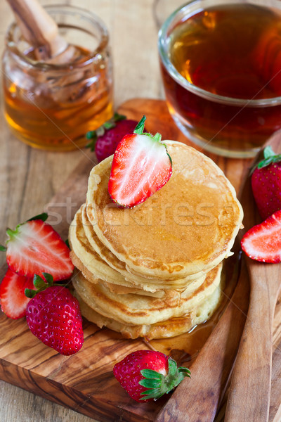 Pancakes with strawberry and honey Stock photo © Karaidel