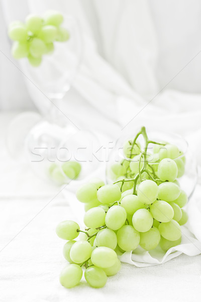 Bunch of grapes in glass Stock photo © Karaidel