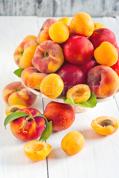 Apricots, nectarines and saturn peaches Stock photo © Karaidel