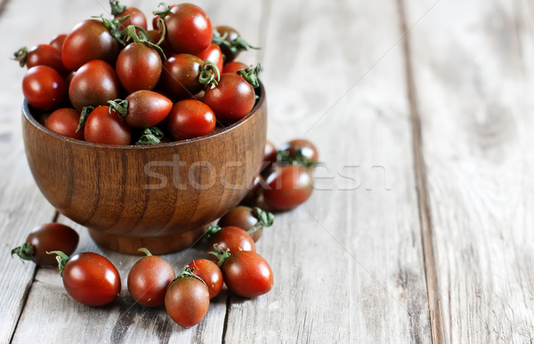 Black cherry tomato background Stock photo © Karaidel