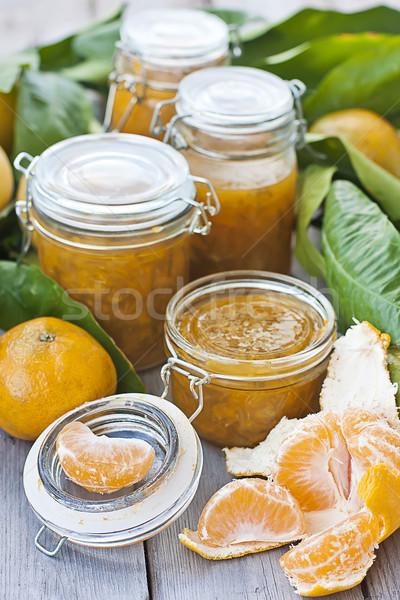 Jars with mandarine jam Stock photo © Karaidel