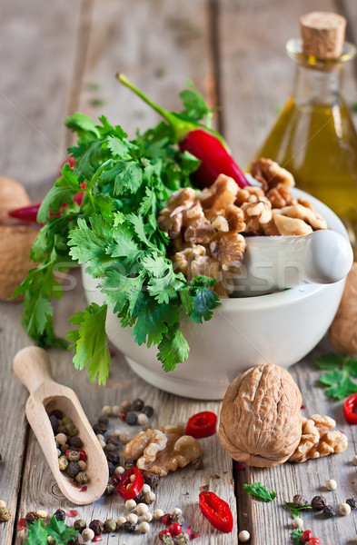 Cilantro and walnuts in a mortar Stock photo © Karaidel
