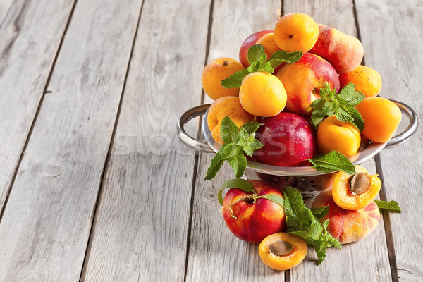 Apricots, nectarines and saturn peaches background Stock photo © Karaidel