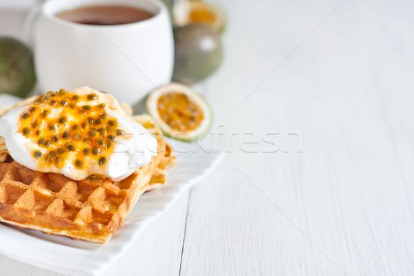 Waffles with cream and passionfruit background Stock photo © Karaidel