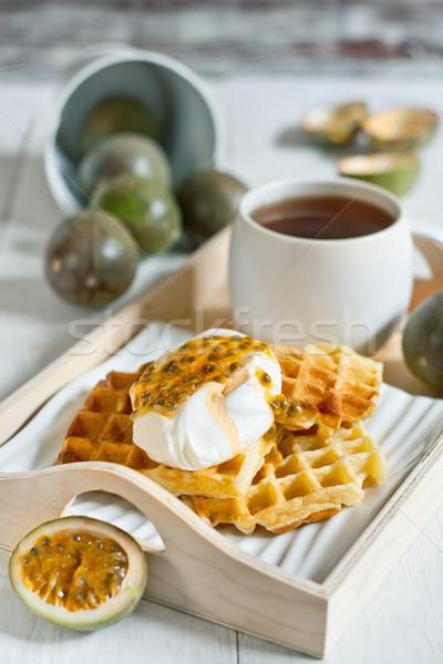 Waffles with cream and passionfruit Stock photo © Karaidel