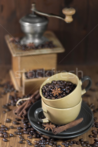 Coffee beans in the cups and old coffee mill Stock photo © Karaidel