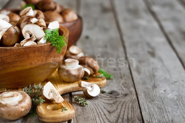 Mushrooms in bowls background Stock photo © Karaidel