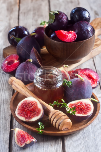 Figs, plums and honey Stock photo © Karaidel
