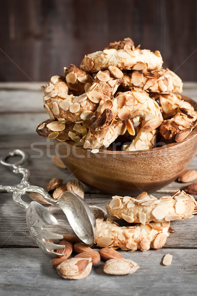 Félhold mandula sütik házi készítésű régi fa torta Stock fotó © Karaidel