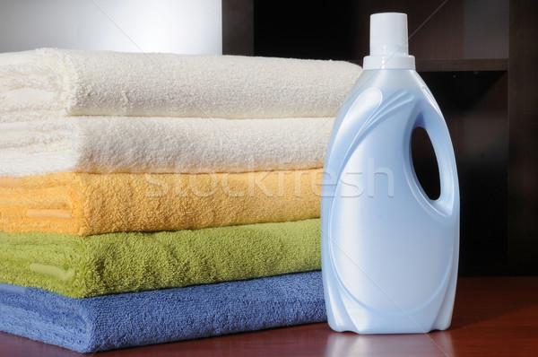 Szennyes mosószer üveg fürdőkád törölközők otthon Stock fotó © karammiri