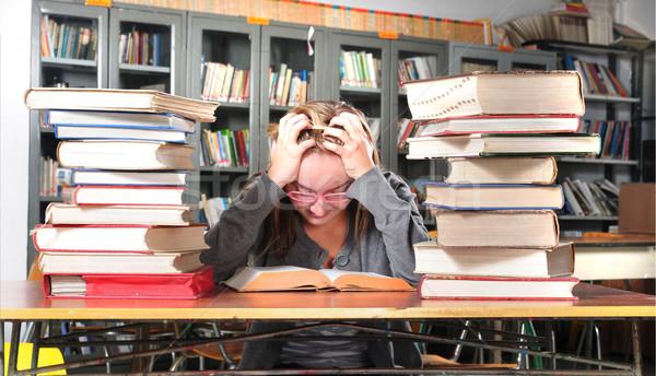 Stock fotó: Tini · diák · könyvtár · olvas · könyv · oktatás