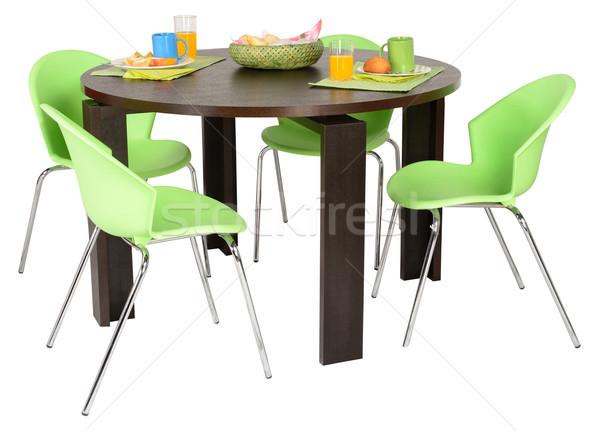 étkezőasztal fa asztal kényelmes székek üveg szoba Stock fotó © karammiri