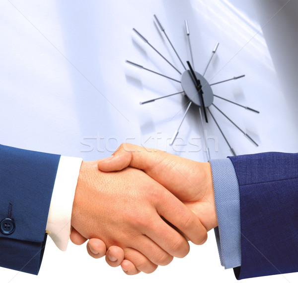 Handshake. Punctuality Stock photo © karammiri