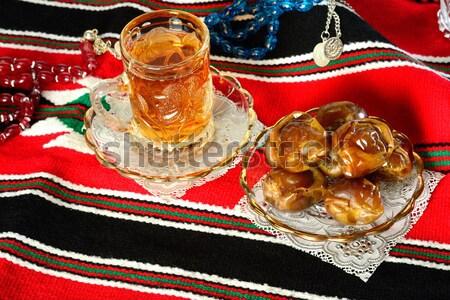 Iszlám könyv datolya tea fény ima Stock fotó © karammiri