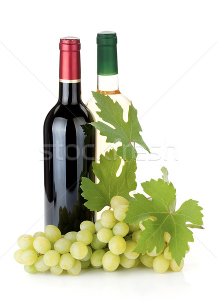 Stock photo: Two wine bottles and grapes