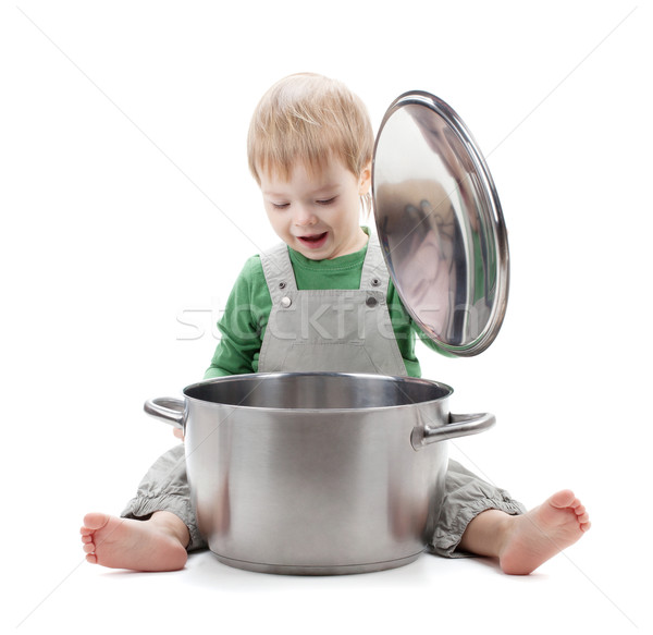 Baby looking inside saucepan Stock photo © karandaev