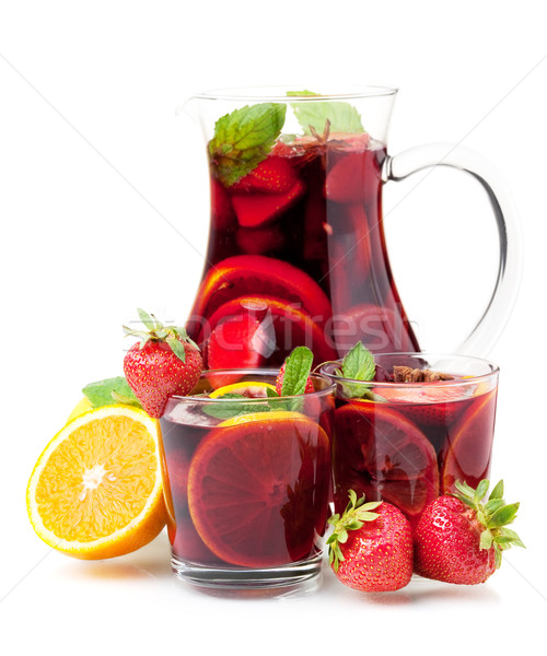 Refreshing fruit sangria in jug and two glasses Stock photo © karandaev