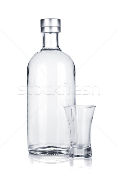 Bottle of vodka and empty shot glass Stock photo © karandaev