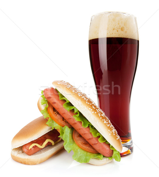Dark beer glass and two hot dogs with various ingredients Stock photo © karandaev