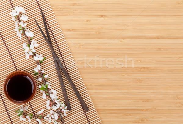 Çin yemek çubukları sakura şube bambu bo çiçek Stok fotoğraf © karandaev