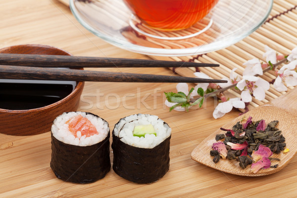 Sushi maki set, herbal tea and sakura branch Stock photo © karandaev