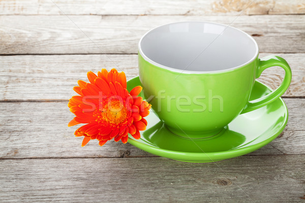 Coffee cup and gerbera flower Stock photo © karandaev