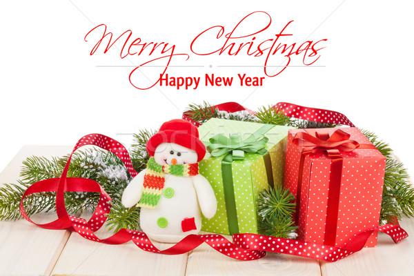 Noël coffrets cadeaux bonhomme de neige jouet isolé Photo stock © karandaev
