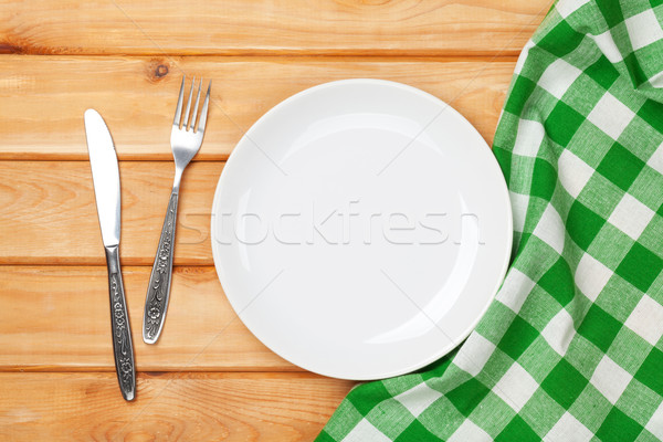 Vide plaque argenterie serviette table en bois Photo stock © karandaev