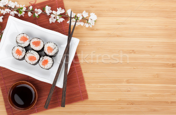 Sushi maki with salmon and sakura branch Stock photo © karandaev