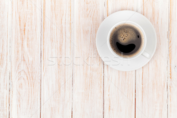 Stock photo: Coffee cup on white wooden table