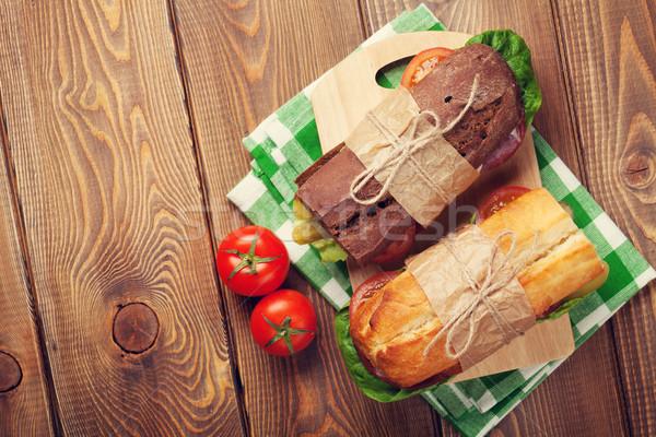 Iki sandviçler salata jambon peynir domates Stok fotoğraf © karandaev