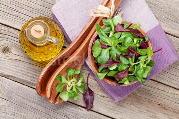 Maïs salade laisse huile d'olive ustensiles table en bois Photo stock © karandaev