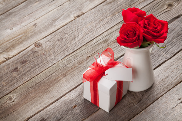 Red rose flowers in pitcher and gift box Stock photo © karandaev
