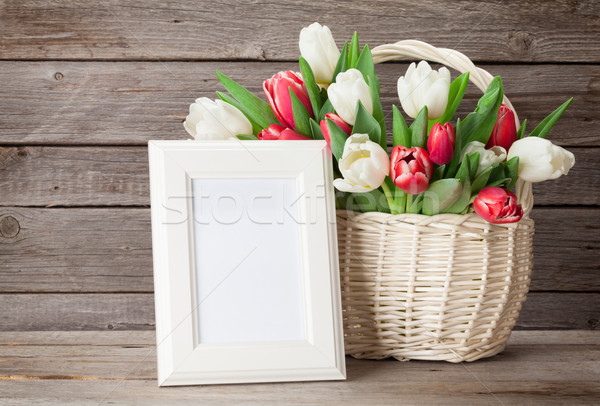 Colorful tulips bouquet and photo frame Stock photo © karandaev