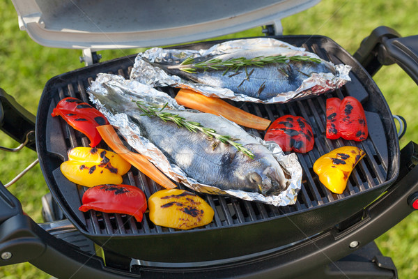 Fresh dorado fish and bell pepper grill cooking Stock photo © karandaev