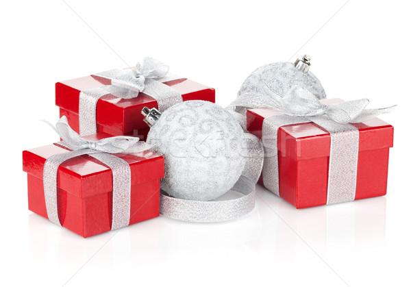 Três natal caixas de presente isolado branco papel Foto stock © karandaev