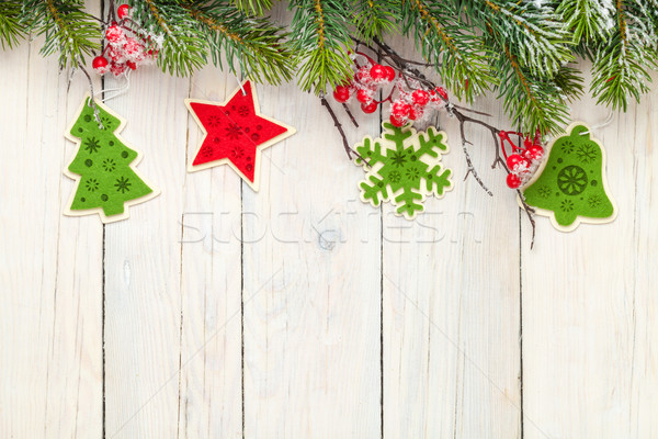 Christmas wooden background with fir tree and decor Stock photo © karandaev
