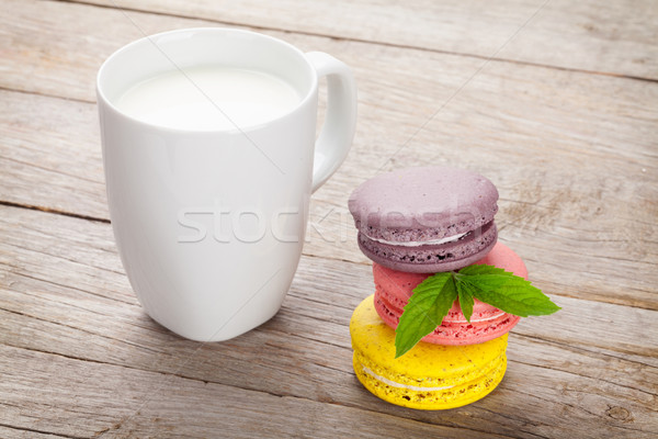 Stock photo: Colorful macaron cookies and cup of milk