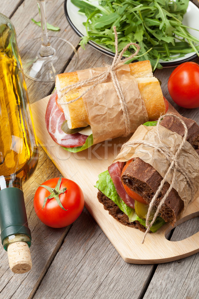 Two sandwiches and white wine Stock photo © karandaev