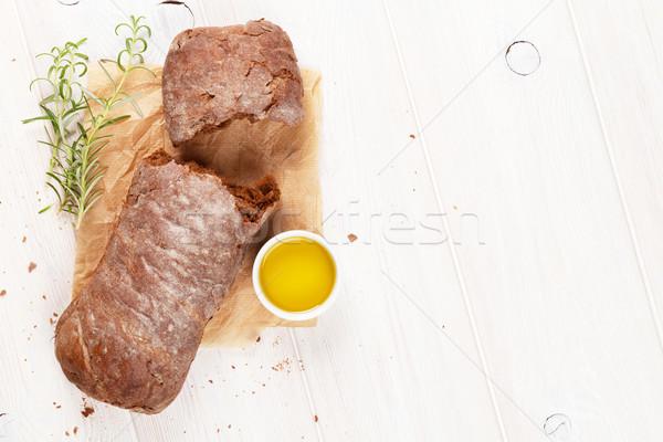 Bruin olijfolie rosmarijn witte houten tafel top Stockfoto © karandaev