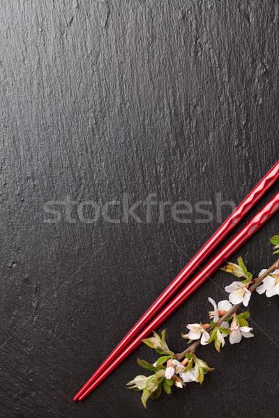 Japanese sushi bacchette sakura fiore nero Foto d'archivio © karandaev