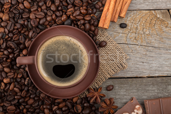 Coffee cup with spices and chocolate on wooden table texture Stock photo © karandaev