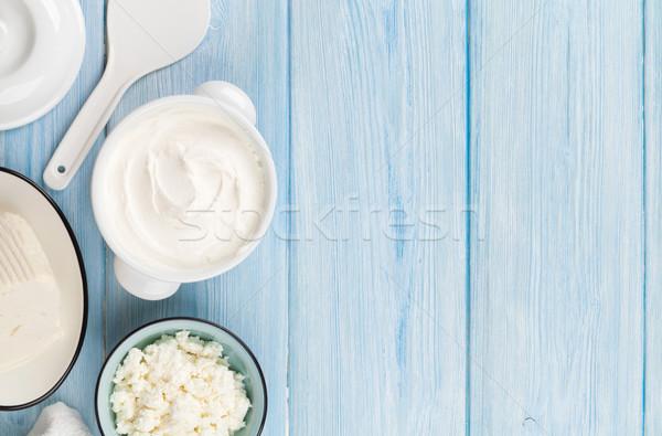 Tejföl tej sajt joghurt tejtermékek fa asztal Stock fotó © karandaev