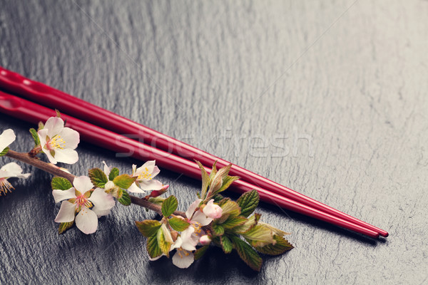 Japans sushi eetstokjes sakura bloesem zwarte Stockfoto © karandaev